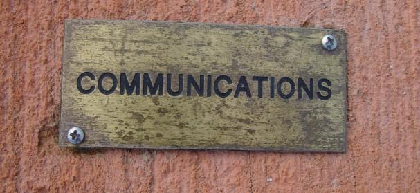 brass-plaque-on-concrete-communications